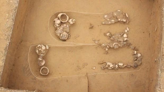Ngôi mộ song táng khai quật năm 2012. (Ảnh: BTLSQG).